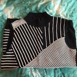 Mock neck, black and white sleeveless sweater